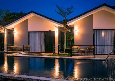 bungalows-pool-night-sandyclay