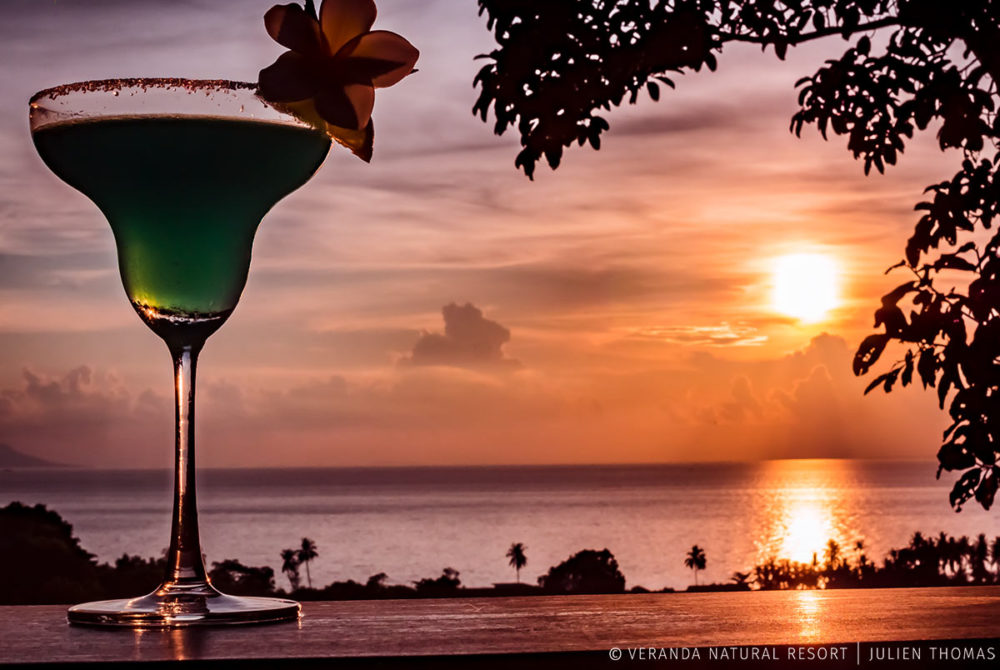 House's cocktail in Veranda Natural Resort on a private terrace of a guest room and facing the sunset over the Gulf of Thailand - Pacific Ocean, Kep - Cambodia.