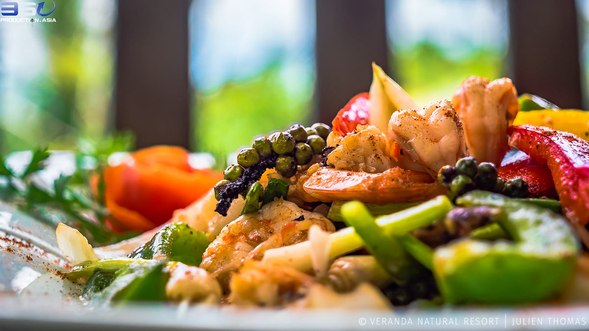 Chef's seafood salad with Kampot pepper, prawns and vegetables on the restaurant menu in Veranda Natural Resort, Kep City, Kep Province - Cambodia