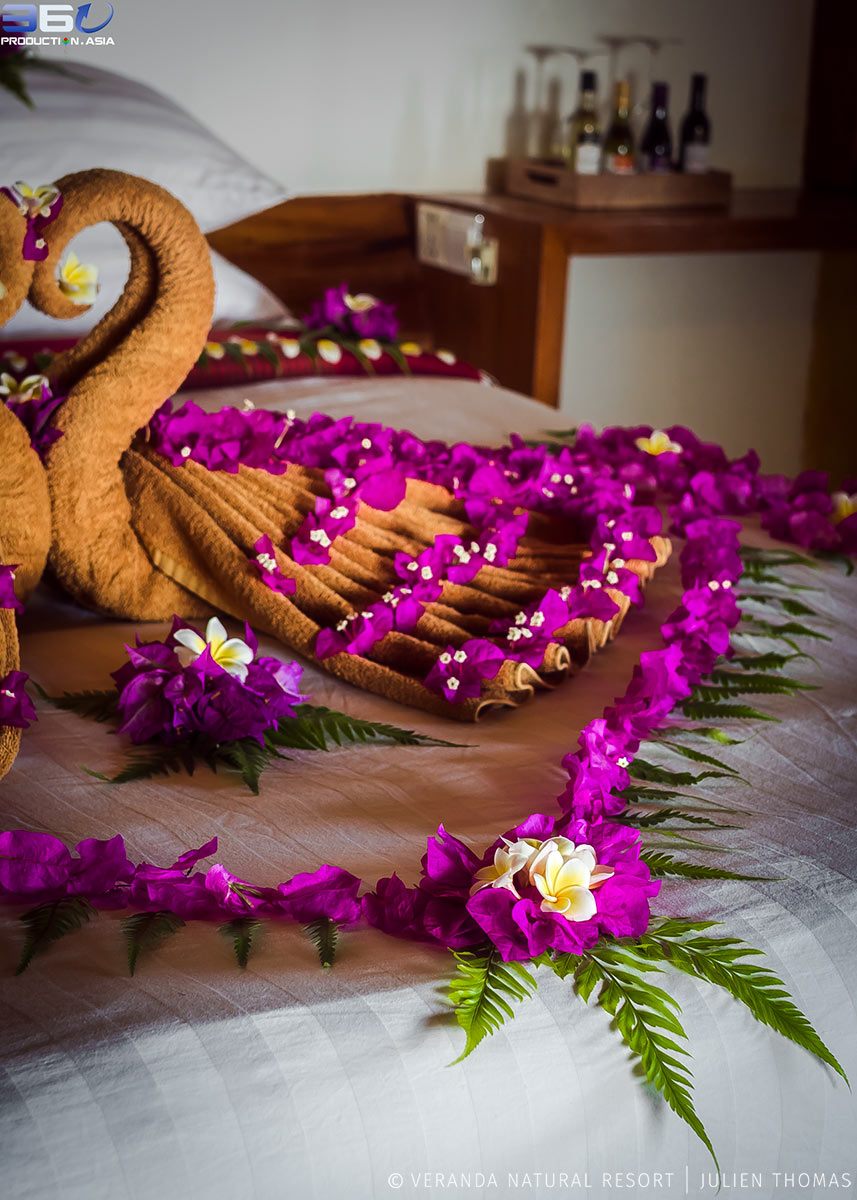 Bedroom decoration for honeymoon with a layout of garden flowers covering the bed in Veranda Natural Resort, Kep - Cambodia