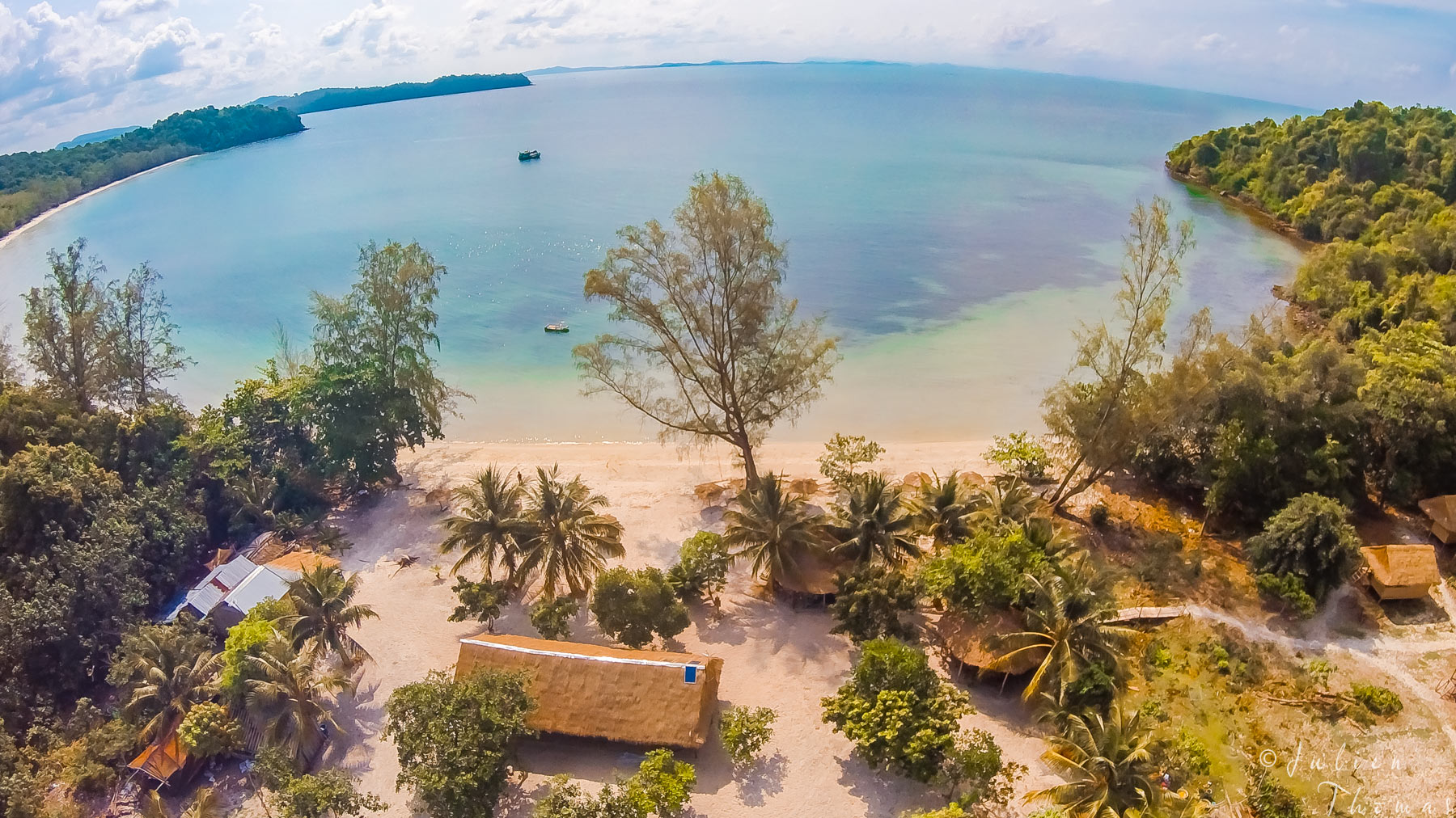 Creek in Koh Ta Kiev Island, Gulf of Thailand - Cambodia with long sandy beach, transparent blue water and bungalows. Drone - aerial photography by Julien Thomas.
