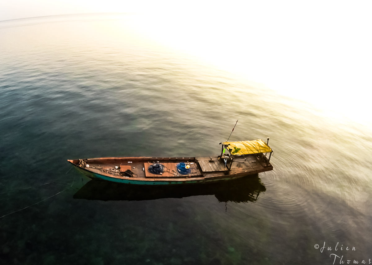 Vietnamese fishing boat in the middle of the Gulf of Thailand - Pacific Ocean during sunrise. Drone - aerial photography by Julien Thomas.