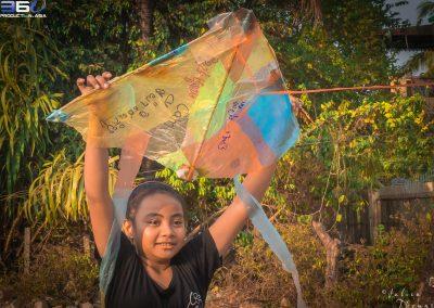 child-kite-waste-play-help