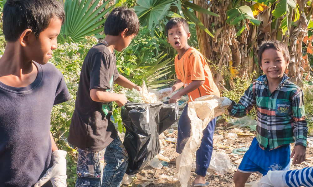 Group of Cambodian schoolchildren are collecting discarded plastic waste - plastic bags for an ecological and creative craft course in Bomnong L'or Organization.
