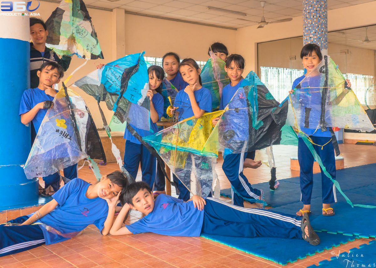 Homemade children's kites crafted by Vietnamese schoolchildren and using plastic waste - plastic bags during a creative & ecological course in NGO Maison Chance.