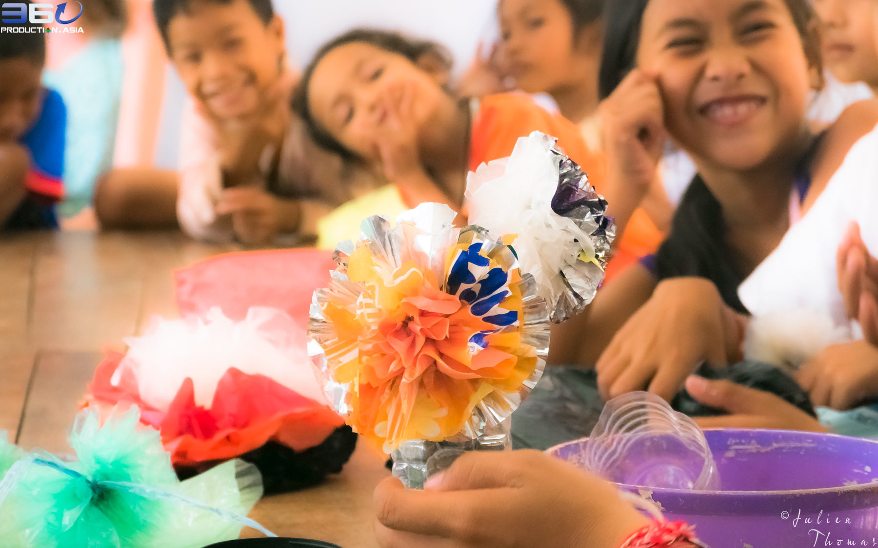 Craft and creative course for schoolchildren using recycled plastic waste bags into multicolor flowers in The Goodwill Center, NGO Bomnong L'or - Sihanoukville.