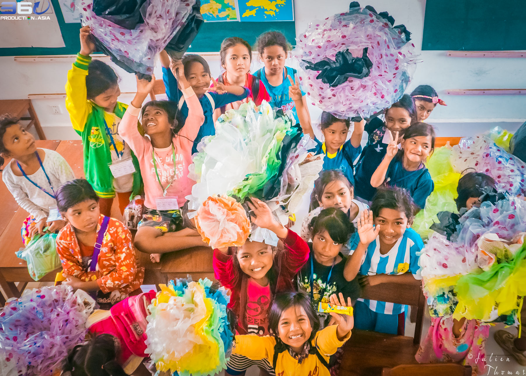 Cambodian participating children have finished to create giant plastic flowers from upcycled waste materials during a craft and recycle course in their school.