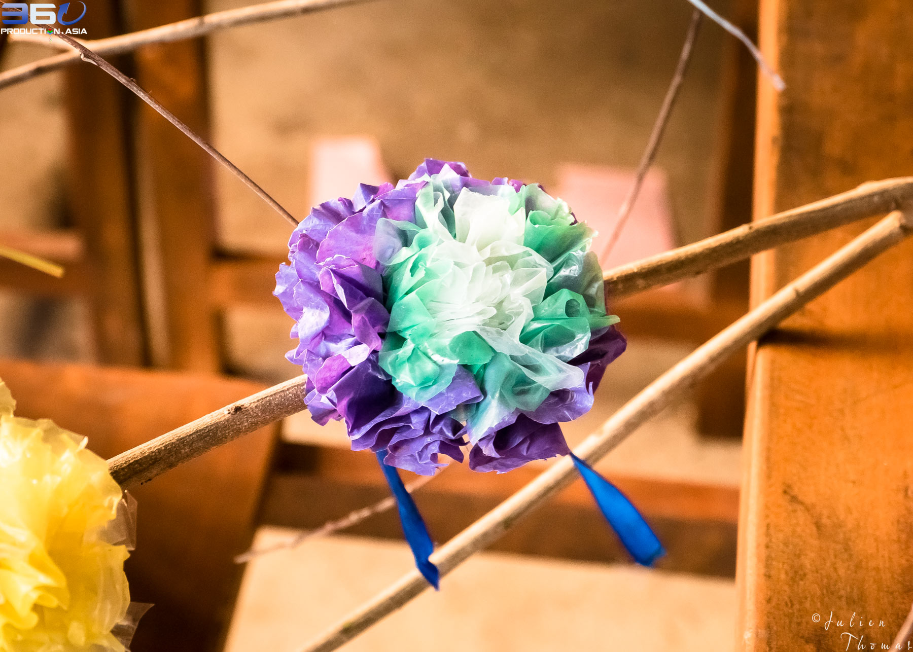 Homemade plastic waste flower created with recycled/upcycled plastic material - plastic bags during a craft and ecological children's course in Cambodia