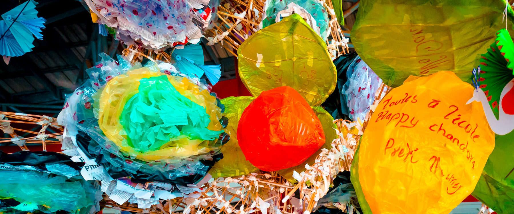 Homemade flowers created by children and from recycled plastic waste are blooming a crafted tree designed by Phare Cambodia in Happy Chandara Secondary School.