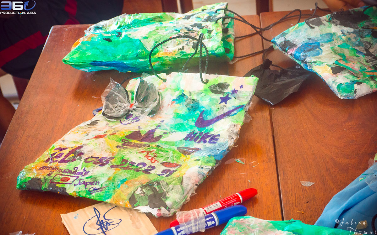 Customized children's purses made and crafted from discarded plastic waste during a creative and ecological course for children in Cambodia, Phnom Penh.