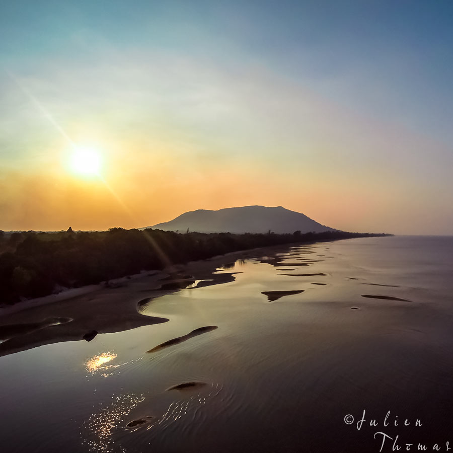 Sunset in Phu Quoc Island, Gulf of Thailand - Pacific Ocean with a calm ocean, deserted beach and landscape. Aerial - drone photography by Julien Thomas.