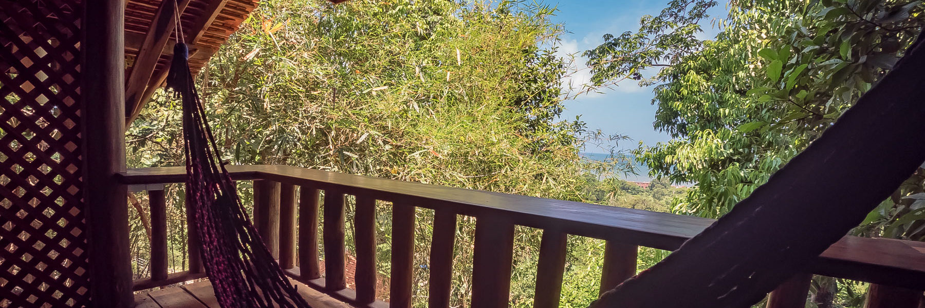 Bungalow Suite Deluxe, private balcony made with natural wood and view to the Gulf of Thailand - Pacific Ocean in Veranda Natural Resort, Kep - Cambodia.