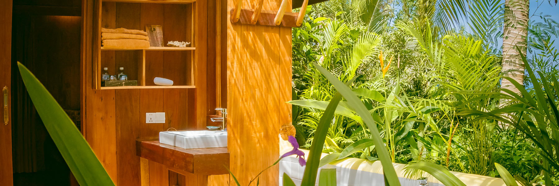 Bungalow Suite Deluxe, open air bathroom with bathtub in a tropical garden and view to the Pacific Ocean in Veranda Natural Resort, Kep - Cambodia.