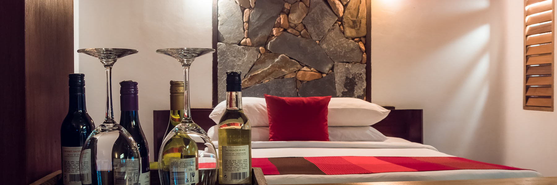 High standing single bedroom with natural stones design and wine degustation at the guest disposal in Veranda Natural Resort, Kep City - Cambodia.