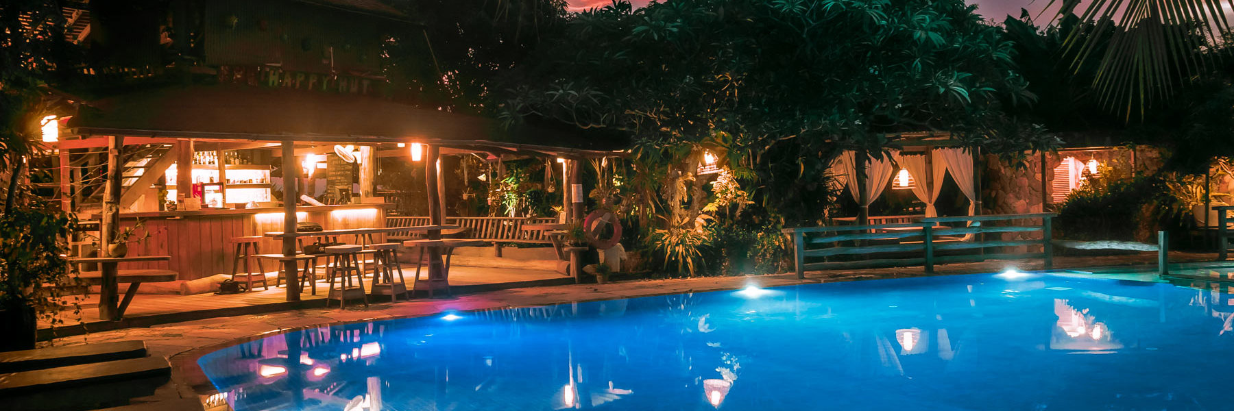 The Secret and Garden Swimming Pool at night with it's bar at guest disposal and tropical plants in Veranda Natural Resort, Kep - Cambodia.