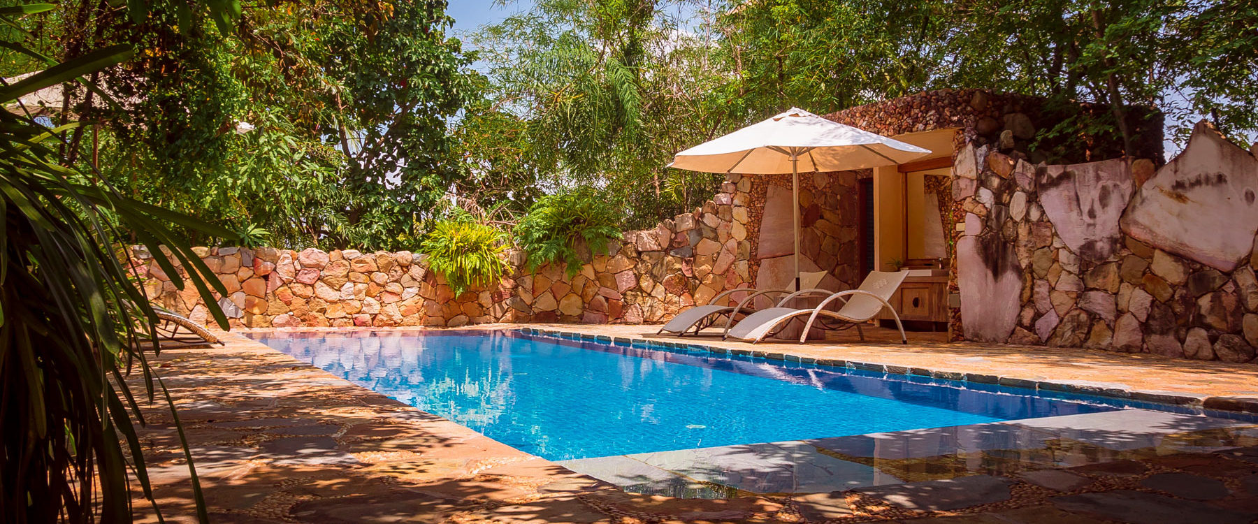Pool Villa, high standing accommodation with private swimming pool and a garden designed with mineral stones and tropical plants in Veranda Natural Resort, Kep - Cambodia.