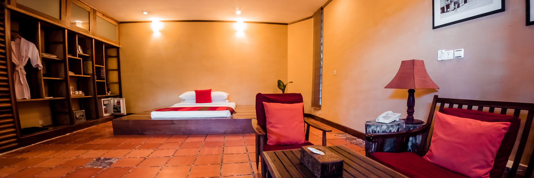 Large Cave Room fully furnished with a double bed, small fridge, small safe, wardrobe and telephone to the hotel reception in Veranda Natural Resort, Kep - Cambodia.