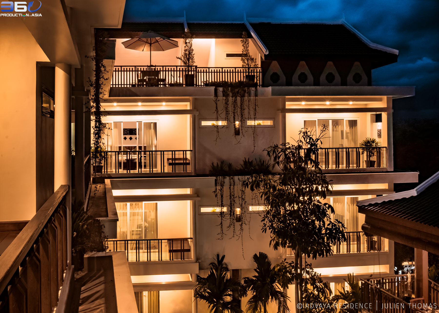 Lighted and luxury hotel at night with the private balconies and rooms for the guests in the high standing Advaya Residence in Siem Reap - Cambodia.