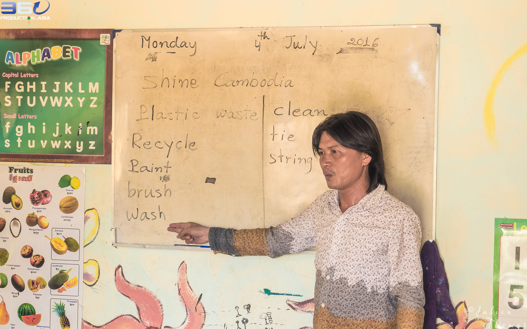 Khmer teacher teaches new words and ecological meanings to his schoolchildren to raise their awareness about the problems of plastic waste pollution in Cambodia.