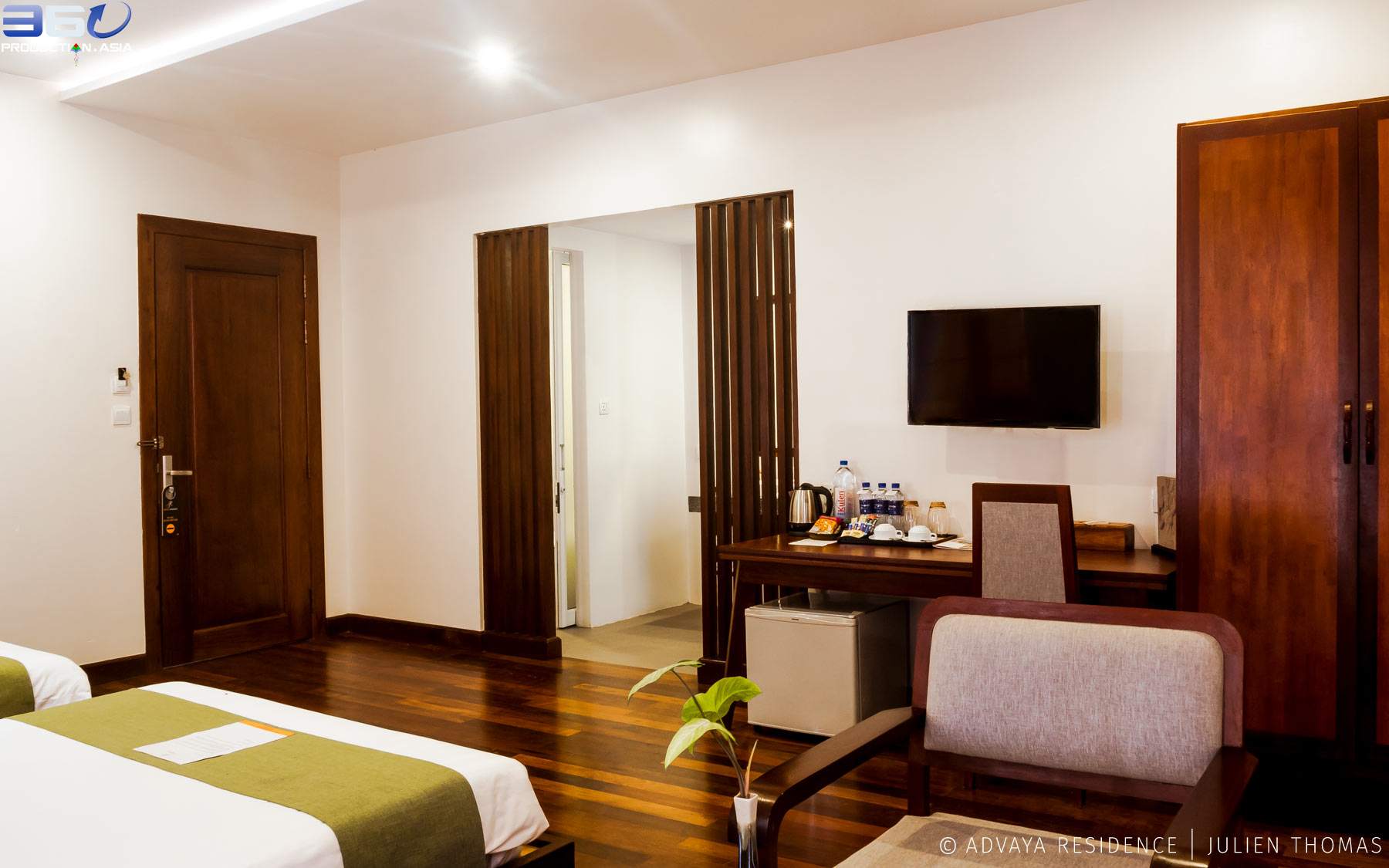 Twin room with wood parquet, private bathroom, small fridge and wardrobe for friends or family in Advaya Residence high standing hotel in Siem Reap, Cambodia.