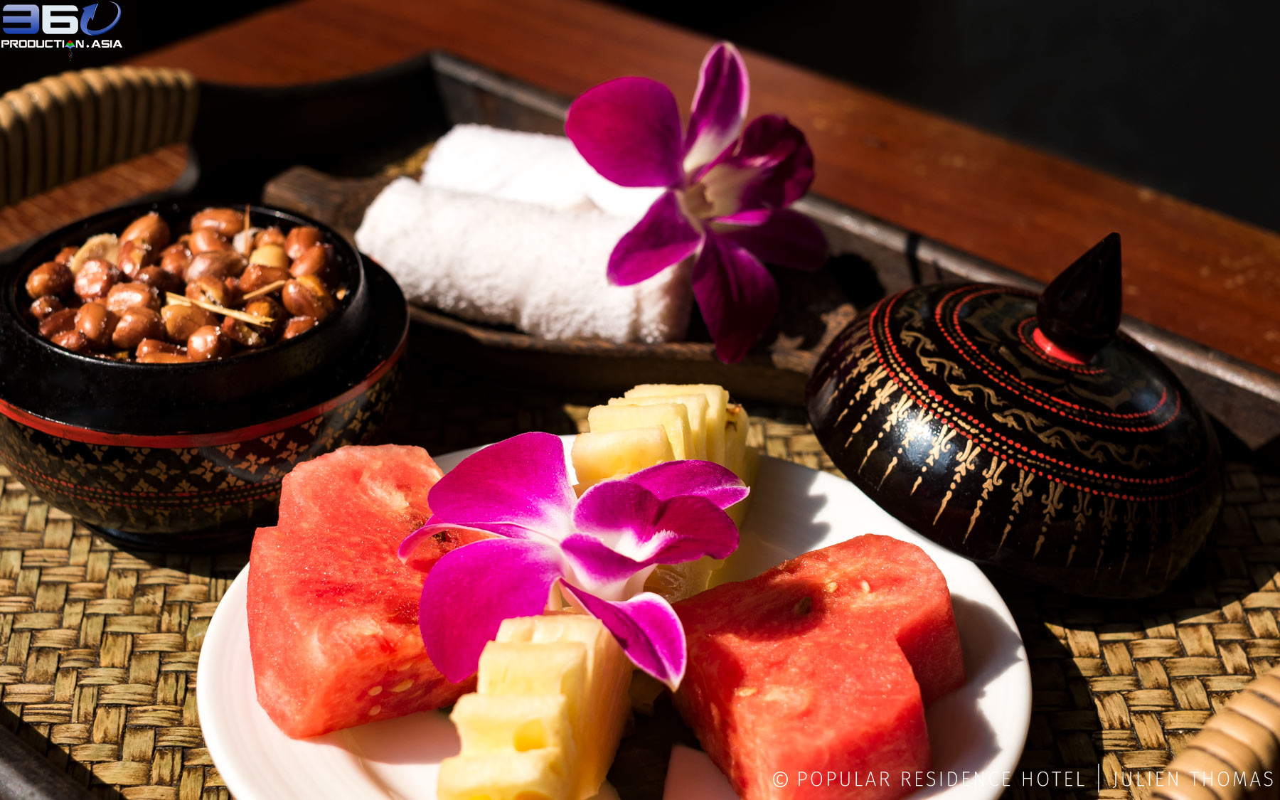 Welcoming snack platter with fresh cut fruits, roasted peanuts and refreshing towels for the travelers in holidays in Popular Residence Hotel, Siem Reap - Cambodia.